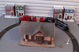 Lionel's battery-powered G-gauge freight train, now discontinued, as it was set up for our Christmas Train Day in 2015.  Click for bigger photo.