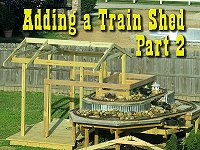 Putting the rafters in place on our garden railway train shed. Click to go to article.