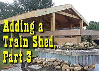 Putting the sheathing and end trim in place on our garden railway train shed. Click to go to article.