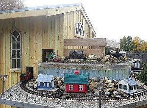 The train shed on the NEW New Boston and Donnels Creek Garden Railroad.  Click to see an article that 'hits the high points' of our construction.