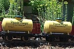 This photo by Wil Davis in 2003 shows two of our 'vinegar cars' repainted from HLW shorty tank cars. Click for a bigger photo.
