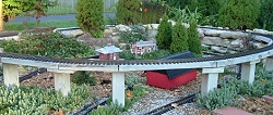Building a simple raised railroad with widely available lumber and common power tools. Click to go to article.