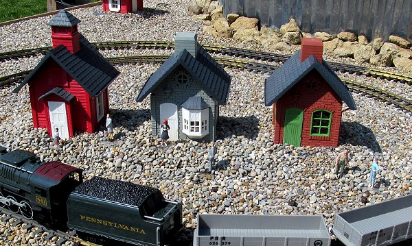 North States bird feeders, Lionel toy train, Chinese figures glued to scrounged PETE.  Click for bigger photo.