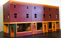 Colorado Model Structures offers this row of storefronts as a single, inexpensive kit.  Click for bigger photo.